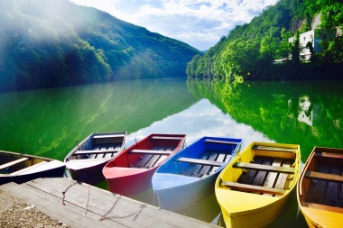 Lillafüred lake with color coordinated boats for rental.